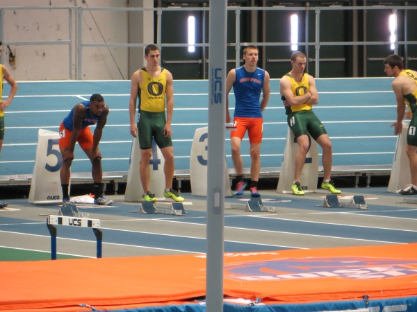 Justin Malnes in lane three lines up in 60m hurdle final.