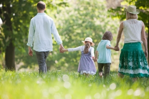 family walking in the meadow